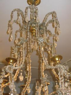 A Carved Gilt Wood and Crystal Eight Light Chandelier - 270053