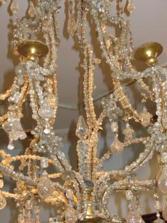 A Carved Gilt Wood and Crystal Eight Light Chandelier - 270054