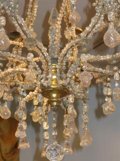 A Carved Gilt Wood and Crystal Eight Light Chandelier - 270055