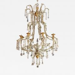 A Carved Gilt Wood and Crystal Eight Light Chandelier - 270970