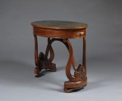 A Charles X Carved Mahogany Oval Writing Table of Unusual Form - 1427184