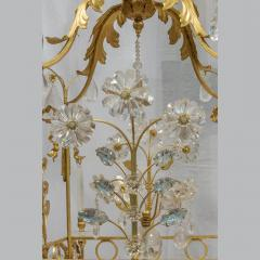 A Charming Gilt Metal and Rock Crystal Cage Formed Eight Light Chandelier - 1444307
