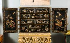 A Chinese Brass Mounted Lacquer Cabinet on a Charles II Gilt wood Stand - 992292