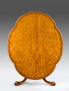 A Gillow satinwood centre table - 778794