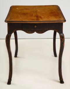 A Hammered Leather and Walnut Table - 2076470