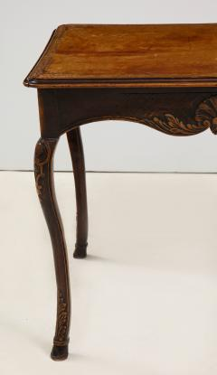A Hammered Leather and Walnut Table - 2076473