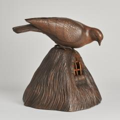 A JAPANESE CARVED WOOD OKIMONO OF A DOVE PEERING INTO A GRAIN STORE  - 1257680