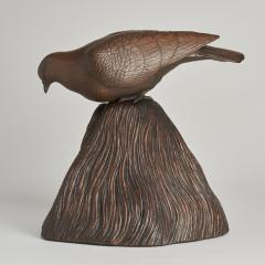 A JAPANESE CARVED WOOD OKIMONO OF A DOVE PEERING INTO A GRAIN STORE  - 1257681