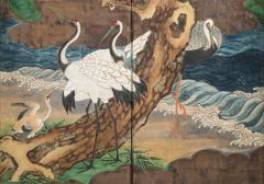 A Japanese 6 Panel Screen of Cranes Amidst Pine Trees by Water - 1064443