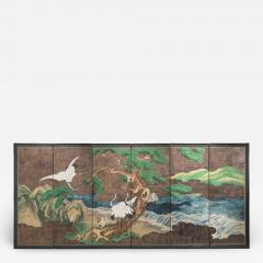 A Japanese 6 Panel Screen of Cranes Amidst Pine Trees by Water - 1065855