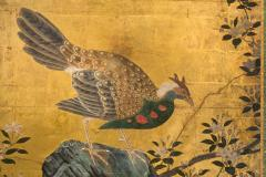 A Japanese Two Panel Screen of a Tragopan Standing on Rocks by Plum Blossoms - 992467