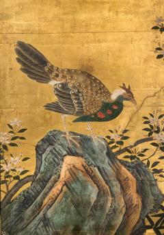 A Japanese Two Panel Screen of a Tragopan Standing on Rocks by Plum Blossoms - 992471