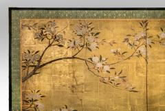 A Japanese Two Panel Screen of a Tragopan Standing on Rocks by Plum Blossoms - 992473