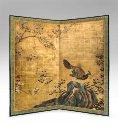 A Japanese Two Panel Screen of a Tragopan Standing on Rocks by Plum Blossoms - 992476