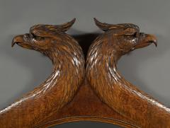 A Large Carved Oak Mirror Surmounted By Addorsed Eagle Heads - 1307685