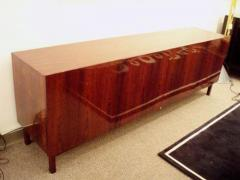 A Long Low Four Door Modernist Sideboard in Rosewood - 254931