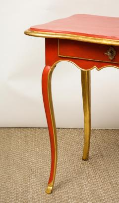 A Louis XV Style Table in Orange with Gold Leaf Accents - 1311132