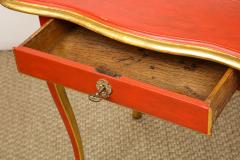 A Louis XV Style Table in Orange with Gold Leaf Accents - 1311135