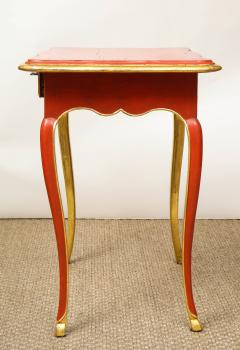 A Louis XV Style Table in Orange with Gold Leaf Accents - 1311136