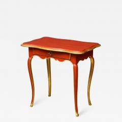 A Louis XV Style Table in Orange with Gold Leaf Accents - 1312962
