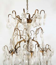 A Louis XV period gilded bronze rock crystal chandelier - 1525732