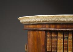 A Mahogany Circular Bookcase With A Statuary Dished Marble Top - 1305263