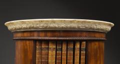 A Mahogany Circular Bookcase With A Statuary Dished Marble Top - 1305264