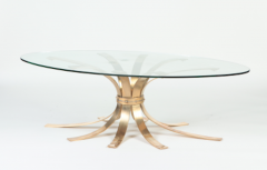 A Mid Century Modern oval bronze coffee table with a glass top France C 1960 - 2129197