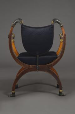A Pair Of Neoclassical X Form Armchairs With Parcel Gilt And Bronzed Detailing - 1457372