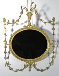 A Pair of George III Oval Giltwood Mirrors - 1073731