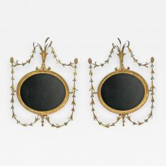 A Pair of George III Oval Giltwood Mirrors - 1074383