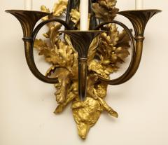 A Pair of Neoclassical Ormolu and Black Painted Three Light Sconce - 615993