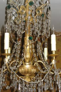 A Pair of Six Arm Carved and Gilded Wood Neoclassic Chandeliers - 269500
