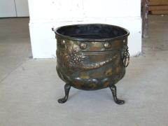 A Patinated Brass Repousee Firewood Vessel - 1359185