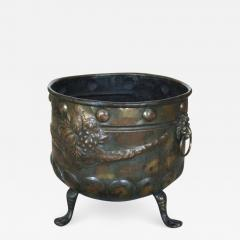 A Patinated Brass Repousee Firewood Vessel - 1362961