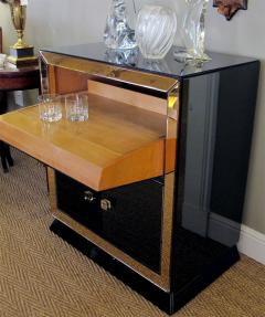 A Sophisticated French Bar with Black Glass and Peach Colored Mirrored Border - 289150