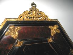 A Tortoise Shell Octagonal Mirror with Applied Bronze Putti - 115634