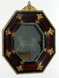 A Tortoise Shell Octagonal Mirror with Applied Bronze Putti - 115635