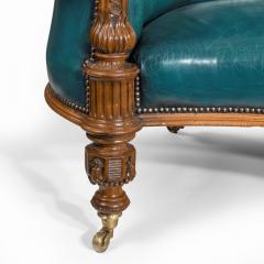 A Victorian carved walnut leathered sofa - 1849238
