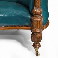 A Victorian carved walnut leathered sofa - 1849240