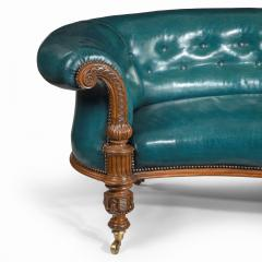 A Victorian carved walnut leathered sofa - 1849243
