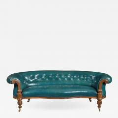 A Victorian carved walnut leathered sofa - 1849596
