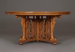 A WALNUT CENTER TABLE BY C MELLIER CO WITH ILLUSIONISTIC PARQUETRY TOP - 968117