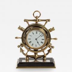 A brass ship s novelty clock presented to Captain Tynte F Hammill RN - 1839926