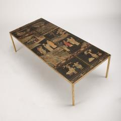 A chinoiseries top coffee table with leather trim on gilt metal base - 1681117