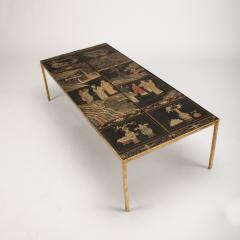 A chinoiseries top coffee table with leather trim on gilt metal base - 1681133
