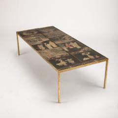 A chinoiseries top coffee table with leather trim on gilt metal base - 1681136