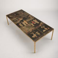 A chinoiseries top coffee table with leather trim on gilt metal base - 1681145