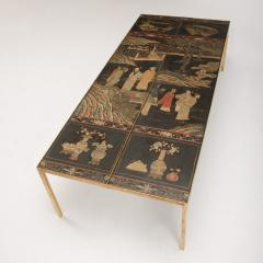 A chinoiseries top coffee table with leather trim on gilt metal base - 1681146