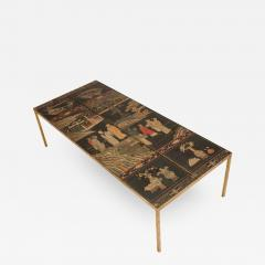 A chinoiseries top coffee table with leather trim on gilt metal base - 1681568